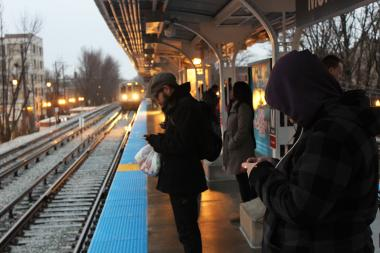 "Commuters boarded trains at the Morse ""L"" station."