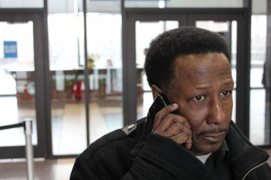 Michael Scott, 57, makes one last call from his cell phone before leaving the George N. Leighton Criminal Courts Building. The courthouse cell phone ban was supposed to go into full effect Monday but now will be introduced over a three-month grace period.