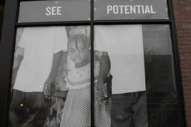 Englewood community members turned out Sunday for the debut of a photo installation at Kusanya Cafe, a coffee shop that hopes to open in the neighborhood next spring.