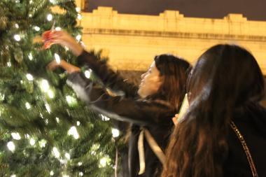 Pilsen residents celebrate the first annual tree lighting ceremony in the neighborhood's plaza at 18th street and Loomis in 2012.