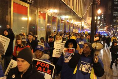 CTU members march from CPS headquarters to 208 South LaSalle St. Tuesday to protest the Board of Education's planned authorization of five new charter schools.