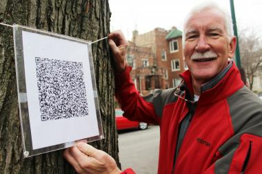 Tom Welch, a former high school principal, hung a QR code from a tree to honor the shooting's 26 victims.
