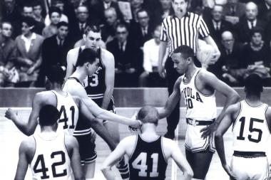 Loyola's Vic Rouse shakes hands with Mississippi State's Stan Brinker at the beginning of the landmark 1963 game.