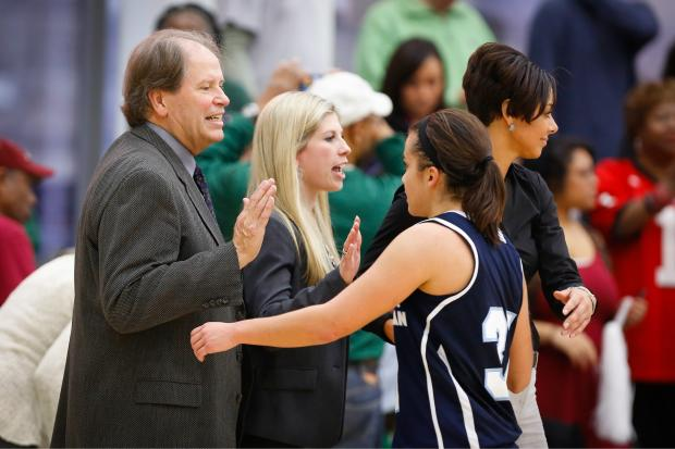 Roosevelt University women's basketball coach Robyn Scherr-Wells is assisted by her father, Marty Scherr, on the bench.