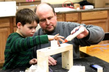 Steve Wafer assists his son, Nathan, 5, with building a menorah during a kids workshop at Home Depot Sunday, Dec. 9, 2012.  Hanukkah continues through this Saturday night.