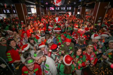 Wrigleyville bars fill up during the Twelve Bars of Christmas, TBOX, bar crawl run by Festa Parties. More than 40,000 people attended on Dec. 15.