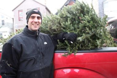 Tom Sonnleitner, 42, was one of 30 people who dropped their Christmas trees into the back of Steve Jensen's pickup truck for recycling over the weekend.