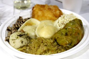A traditional Polish Christmas Eve Wigilia meal does not include red meat. On this loaded plate: pirogies, pasta sprinkled with poppy seeds and raisins, cabbage rolls and breaded fish represent foods from the orchard, field, forest and waters.