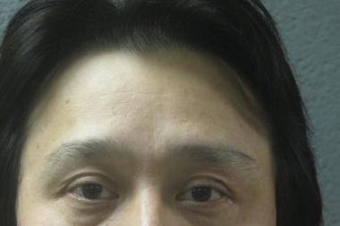 Xiao Jin You, 45, of Chicago, was charged with possession of counterfeit trademarked goods.