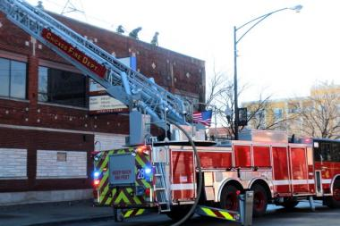 A fire broke out on the roof of the Rebano Church at 2435 W. Division St. Monday, while contracters were working on the building's roof, 12th District Officer Tom Povsner said.