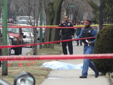 A man in his 20's was killed and two others injured by gunfire in Greater Grand Crossing, according to police and the Cook County Medical Examiner's Office. The shooting occurred at about 12:10 p.m. in the 7500 block of South Champlain Avenue, police said.