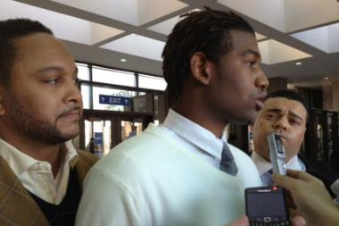 Andre Curry speaks with reporters after he was sentenced to probation Friday for taping up his daughter and posting a picture on Facebook. He is flanked by the Rev. Torrey Barrett (l.) and his attorney, Sam Adam Jr.