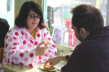 Kristin Riehl and Andy Karrick get in the spirit of Angel Food's Hangover Brunch, snagging free donuts for wearing their pajamas.