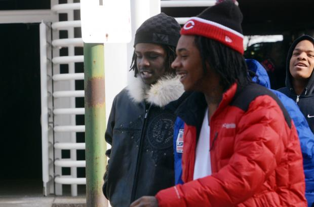Chief Keef, brown jacket, walks into Juvenile Court on Jan. 15, 2013, with friend Capo.