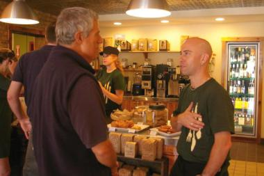 Cleetus Friedman (r), chef and owner of City Provisions, greeting customers in happier times.