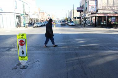 A man crosses the intersection at Devon and Maplewood avenues, where Tsering Dorjee was struck and killed by a hit-and-run motorist on Nov. 12, 2012.