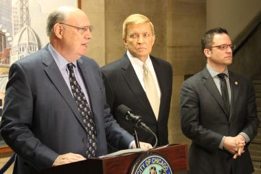 Professor Dick Simpson details charges of police corruption, flanked by Ald. Bob Fioretti and Ald. Proco Joe Moreno.