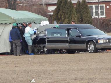The body of Urooj Khan was placed into a hearse to be taken to the Cook County Medical Examiner's office Friday.