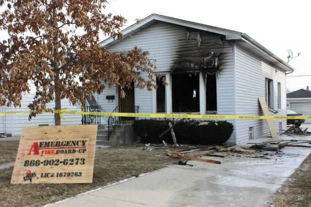 A woman was found dead on the scene of a fire in Jefferson Park.