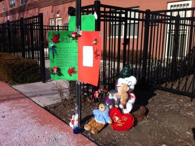 A makeshift memorial is shown Wednesday near the spot where Kevin Jemison, 28, was fatally shot the day before in the 4500 block of South Champlain Avenue.