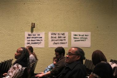 South Shore residents listen to speeches on improving their neighborhood at a rally by Rebuild South Shore for All.