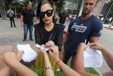 Lady Gaga signs autographs for fans outside a hotel in South America last November.
