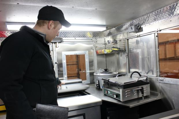 Dan Salls started with an ice cream truck and built a mobile kitchen he hopes is up to the city's standards.