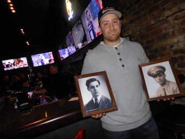Marc Nichols, who just opened Vincenzo's Pizzeria at 1104 W. Madison St. in the West Loop, holds pictures of his grandfather, the restaurant's namesake.