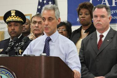 Flanked by Chief of Patrol Joe Patterson (left) and Superintendent Garry McCarthy (right), Mayor Rahm Emanuel announces changes in the community-policing program Tuesday.