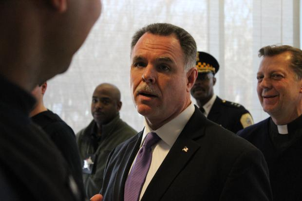 Police Superintendent Garry McCarthy showcases seized guns while calling for tougher gun laws.