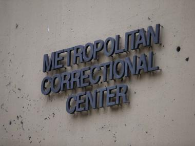 A sign hangs on the side of the federal Metropolitan Correctional Center in the Loop.