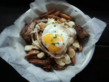 Edgy River North eatery BadHappy is adding its signature french fry dish to its delivery menu starting Thursday.