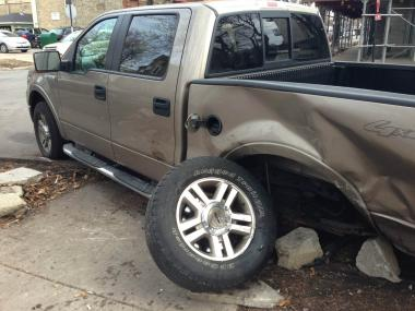A driver of a stolen Jeep crashed into this truck near West School and North Paulina streets Thursday morning after taking police on a chase from Hermosa to Lakeview.