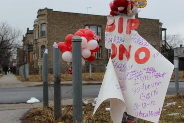 A makeshift memorial of teddy bears, balloons and poster cards decorate the corner of West Congress Parkway and South Kildare Avenue to remember Antonio Fenner and Dimitri Buford, who were shot and killed Saturday afternoon.