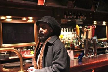 Asrat Selassie, an owner of the Wild Hare, believes racial bias is behind opposition to a live music license for his bar, which proposed free parking to address traffic concerns.