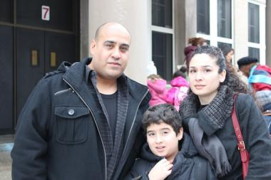 Patrick Rosero (l.) and Linda Reyes with their son, Julius, outside Inter-American Magnet School