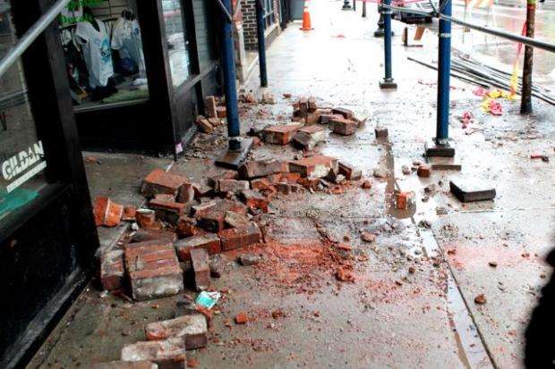 Around 8 a.m. Sunday, brick from a building above a T-Shirt shop fell onto the sidewalk in front of 1418 N. Milwaukee Avenue.  A CleanSlate worker witnessed the fall, police said.  No injuries were reported.