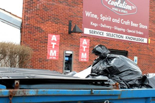 A 24-Hour ATM was installed in early February at 1704 N. Milwaukee Ave. on the southern end of a strip mall. The machine's location, in front of a handicap parking space, obscured by a garbage bin and next to a wall and bush has puzzled some regulars at the mall, who nonetheless said they're happy the machine is there — even if they only plan to use it during the day, or when the stores are open.