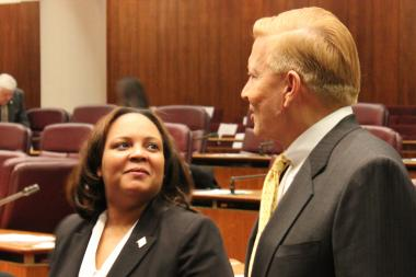 Natashia Holmes chats with Ald. Bob Fioretti before Wednesday's City Council meeting.