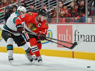 Blackhawks captain Jonathan Toews (right) battles against San Jose's Jason Demers during Chicago's 2-1 victory on Friday.