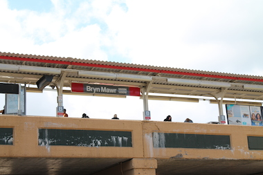 Commuters wait for a train at the Red Line's Bryn Mawr stop in Edgewater.