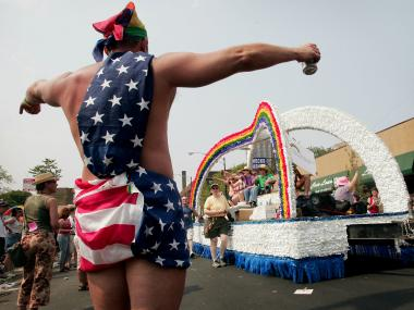 Parade participants dance on a float as it travels through the city's gay district during the 36th annual Gay and Lesbian Pride Parade in June 2005.