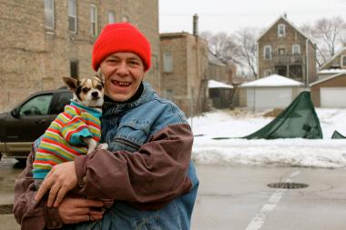 "Dave McLaughlin, 54, of Bridgeport, carries ""Donkey,""  a Chihuahua-Terrier mix."