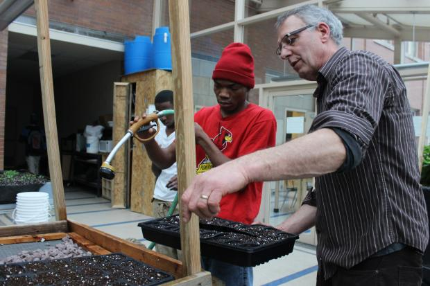 Students learn about healthy eating and nurturing plant life at the school's indoor greenhouse.