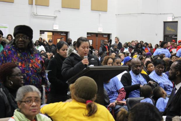 Parents, teachers and activists filled a church gymnasium to talk about school closures.