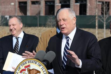Gov. Pat Quinn stands in front of a Super Wal-Mart construction site in Pullman. (Feb. 18, 2013)