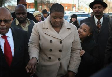 Cleopatra Cowley-Pendleton arrives Friday with her son Nathaniel for the wake of her 15-year-old daughter, Hadiya, at the Calahan Funeral Home in Chicago.