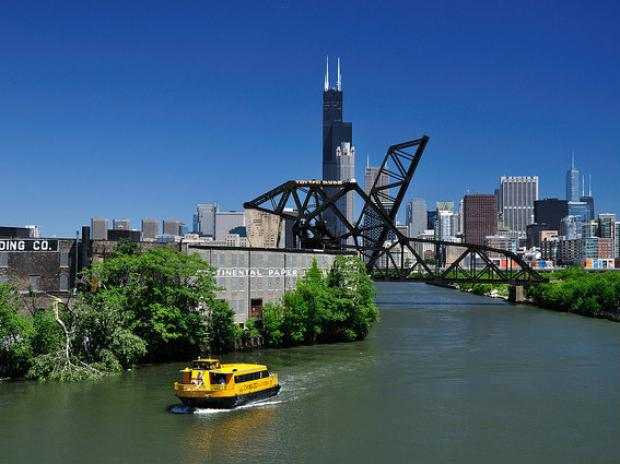 A Chicago Water Taxi floats along the south branch of the Chicago River.