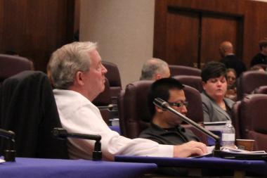 James Houlihan and Tony Hu weigh testimony at the Commission on Chicago Landmarks' meeting on Prentice Women's Hospital in November.