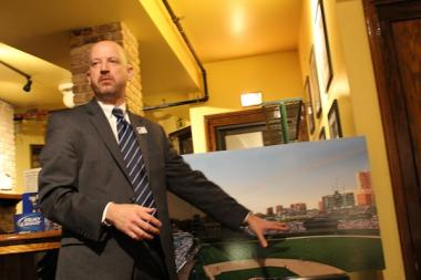 Mike Lufrano, the Cubs' executive vice president of community affairs, shows East Lake View Neighbors Wrigley Field renovation renderings on Feb. 5, 2013.